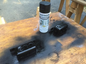 Spray painting the two visible outlet boxes black.