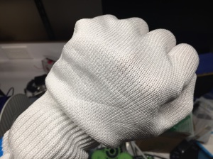 You can see the lines left from earlier attempts to cut into the glove.