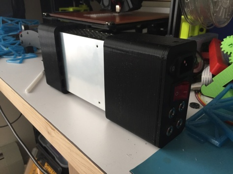 Side view of completed power supply case in black PLA