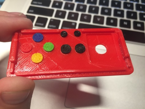 Test fit all of your buttons ahead of time. Place them into the lid as shown and snap the case on while oriented this way.